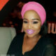 Winnie Mashaba displays an assortment of wigs and hairstyles for new album cover photoshoot