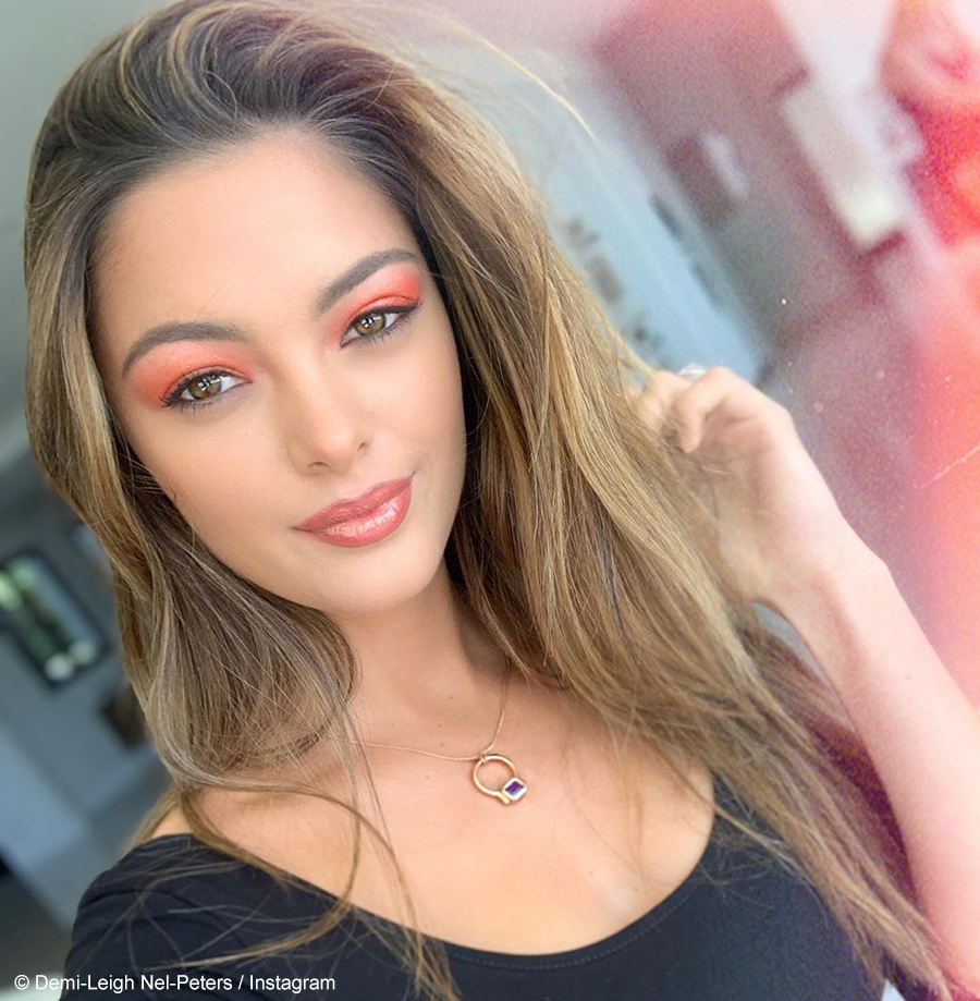 Demi-Leigh Nel-Peters pairs bold, red lipstick with tangerine dress