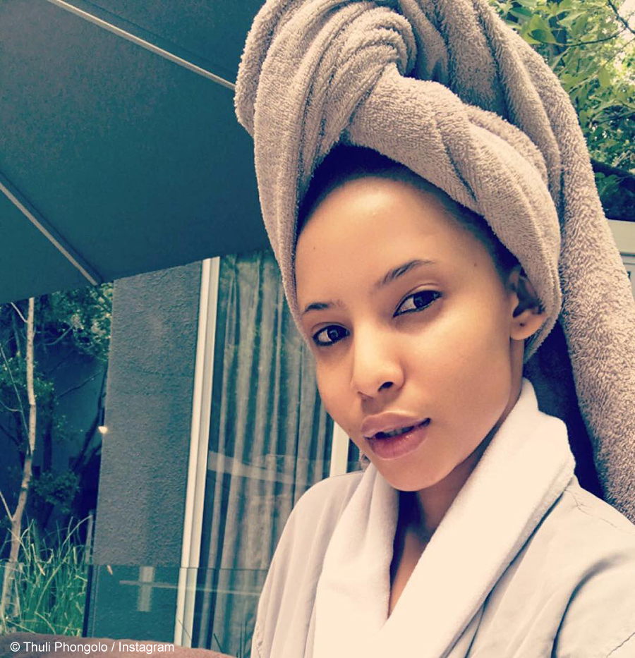 Thuli Phongolo shows off her natural hair whilst using the Steamplus straightener
