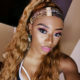 DJ Zinhle poses in turban-styled headscarf in Mauritius