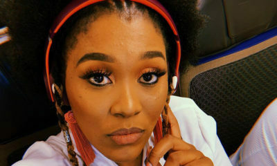 Lady Zamar promotes current single, Sunshine, in t-shirt and plaid pants
