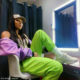 DJ Zinhle opts for a relaxed look in neon green tracksuit pants