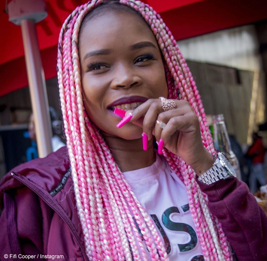 Fifi Cooper shows off her bright pink floor-length braids