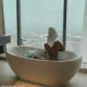 Mihlali Ndamase posts bathtub picture, crediting Lewis Hamilton as the photographer
