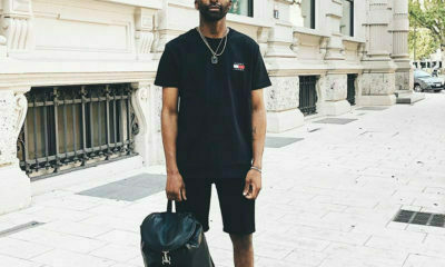 Riky Rick steps out in head-to-toe Tommy Hilfiger while visiting the store in Milan, Italy