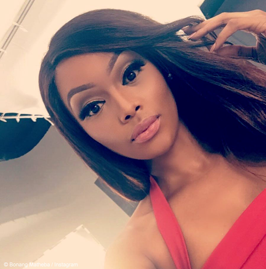 Bonang Matheba wears bold make-up and long, sleek hair in Lagos