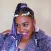 Sho Madjozi wears eccentric make-up and pink hair in WWE advertisement