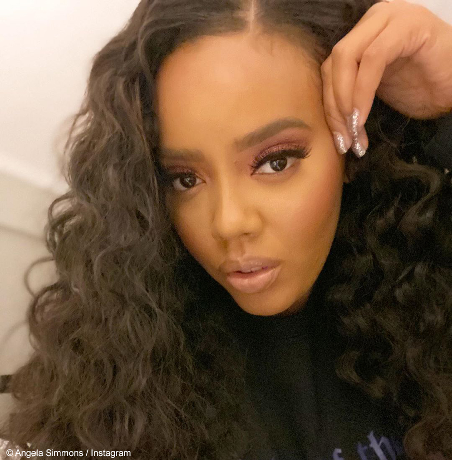 Angela Simmons debuts long, curly wig