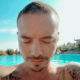 J Balvin shows off his upper body tattoos