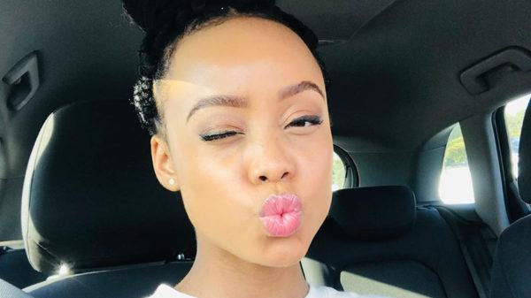 Ntando Duma wears black and turquoise bikini during Cape Town vacation