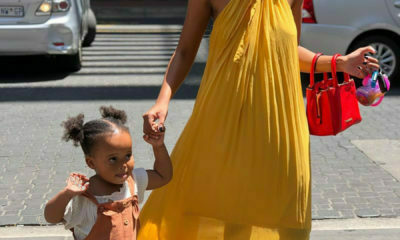 Ntando Duma walks the Khosi Nkosi runway with her daughter, Sbahle, at AFI Fashion Week
