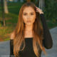Catherine Paiz shows off her extra-long blonde extensions