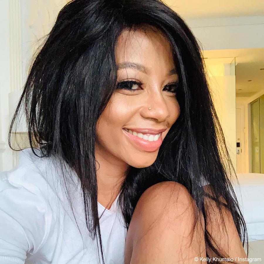 Kelly Khumalo showcases black, side-part wig