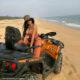 Bonang Matheba quad bikes by the coast in Nigeria