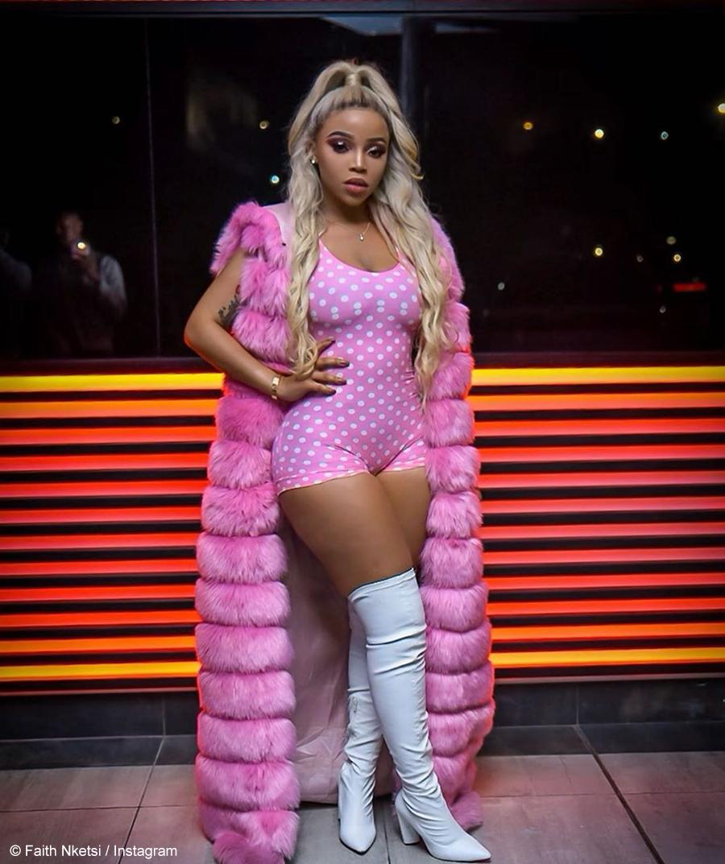 Faith Nketsi dresses in a pink and white Fashion Nova ensemble