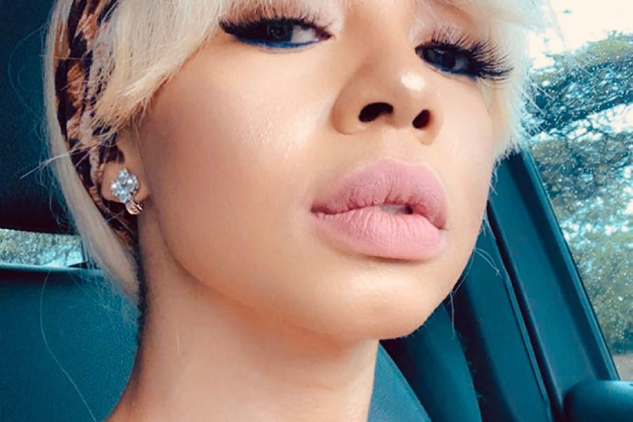 Kelly Khumalo reveals new tattoo, covering wedding finger tattoo received with Chad Da Don - JustNje