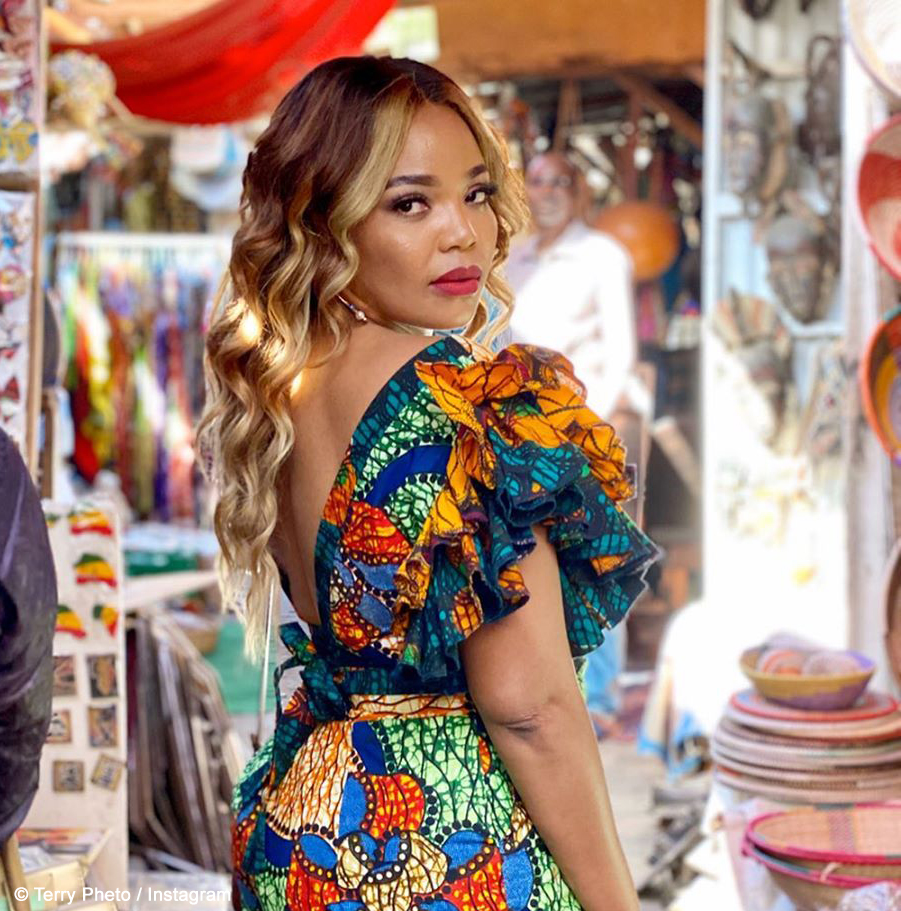 Terry Pheto showcases bold red lip while vacationing in Senegal