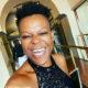 Zodwa Wabantu maintains her hairstyle using a tennis racket