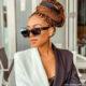 Blue Mbombo styles honey blonde braids in low bun