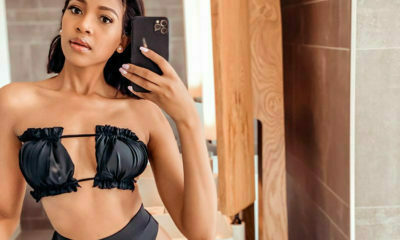 Blue Mbombo models black bikini from Tee Stylish