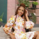 Blue Mbombo wears floral print dress from Blue Chic for Afternoon Express appearance