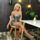 Faith Nketsi poses in a silver strapless dress for her birthday