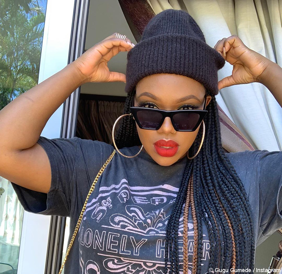 Gugu Gumede wears oversized outfit with Nike sneakers
