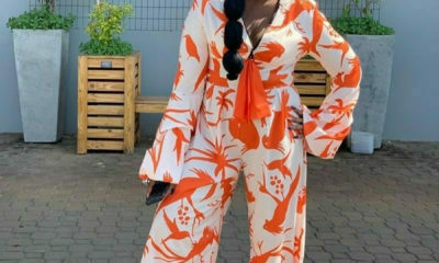 Kwa Mam'Mkhize's Shauwn Mkhize wears print jumpsuit with black slippers