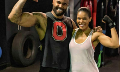 Mike Bless applauds Connie Ferguson's strength at the gym