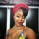 Minnie Dlamini Jones pairs soft glam make-up look with red lipstick