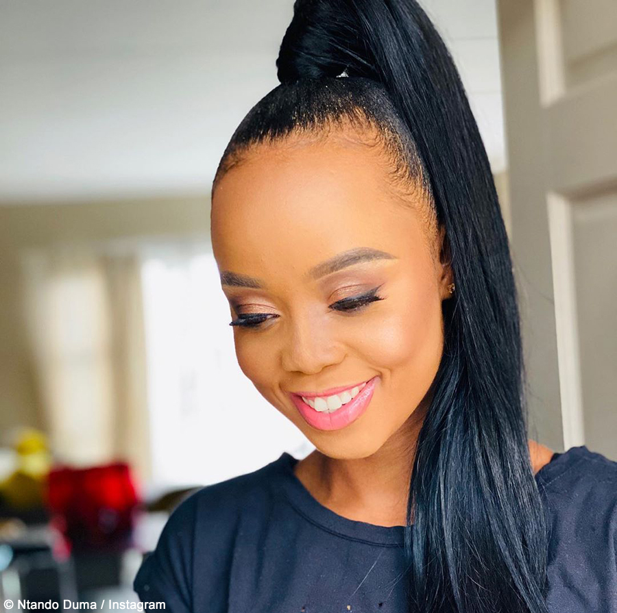 Ntando Duma poses in a top knot hairstyle in promotional post for Fashion Never