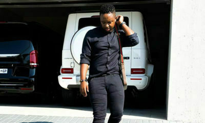 Shimza poses in all-black outfit against white Mercedes Benz G Wagon
