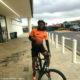 Siphiwe Tshabalala showcases orange and black cycling ensemble