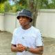 Zakhele Lepasa wears Puma t-shirt with black bucket hat