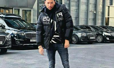 AKA showcases Valentino bomber jacket during his Seoul vacation