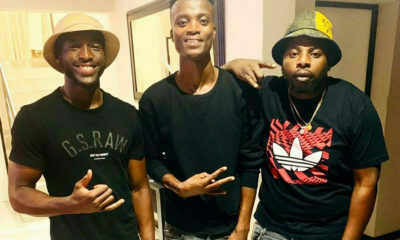 DJ Maphorisa poses in denim and black outfit alongside King Monada and DaliWonga