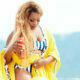 Jessica Nkosi pairs monochrome swimsuit with yellow cover-up