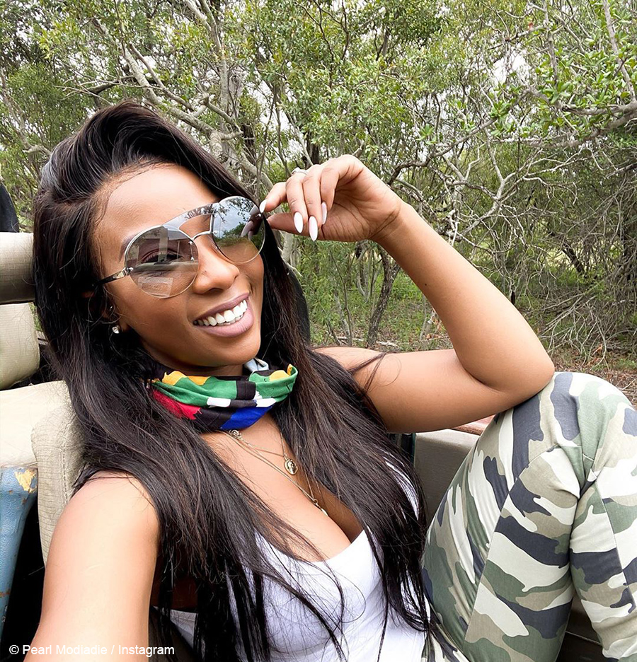 Pearl Modiadie pairs camouflage pants with white tank top at Leadwood Big Game Estate
