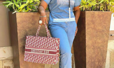 Shauwn Mkhize accessorises blue outfit with Christian Dior handbag and sneakers