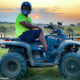 Shimza goes quad biking in green and black outfit