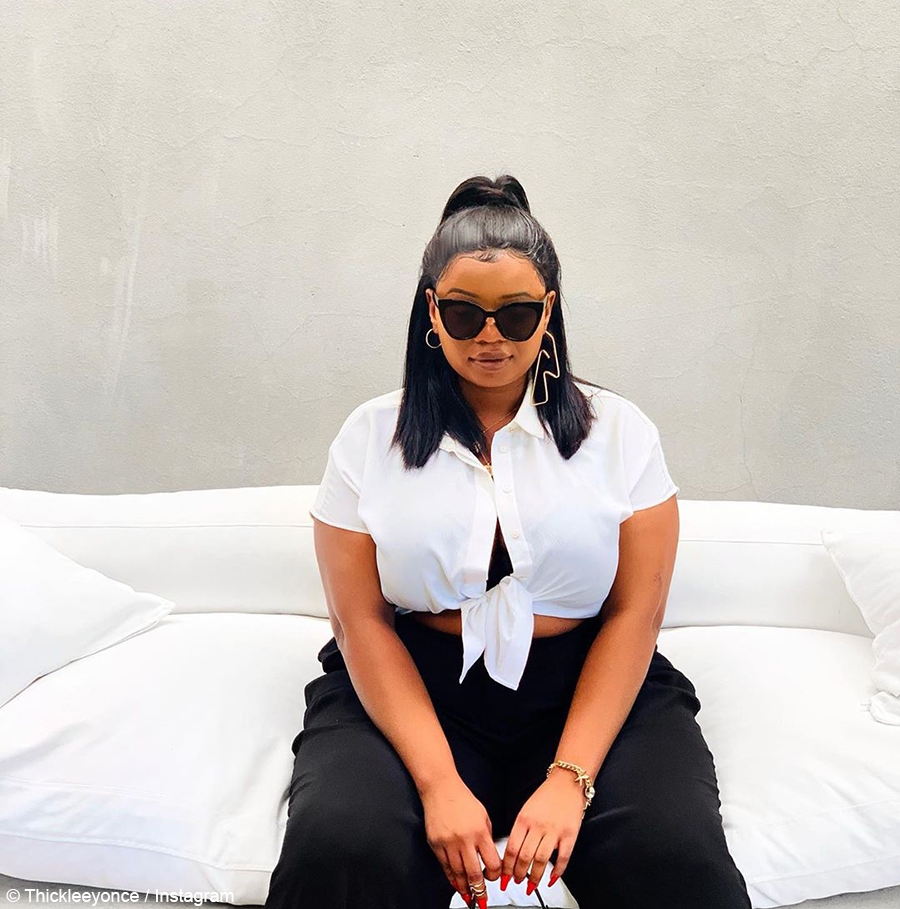 Thickleeyonce poses in black and white outfit
