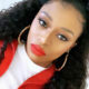 DJ Zinhle sports red lip while showcasing look by celebrity makeup artist, Audrey Mofokeng