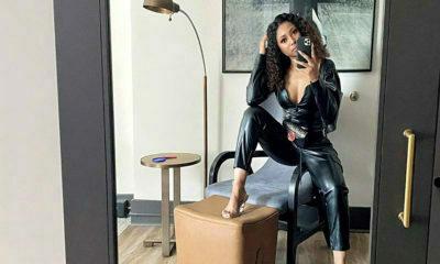 Enhle Mbali poses in leather ensemble