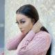 Khanyi Mbau showcases lavender eyeshadow look and sleek, black hair
