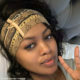 Lerato Kganyago lounges in Louis Vuitton headscarf