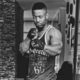 Prince Kaybee works on biceps in his home gym