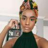 Zozibini Tunzi pairs patterned headscarf with hoop earrings in latest Instagram post