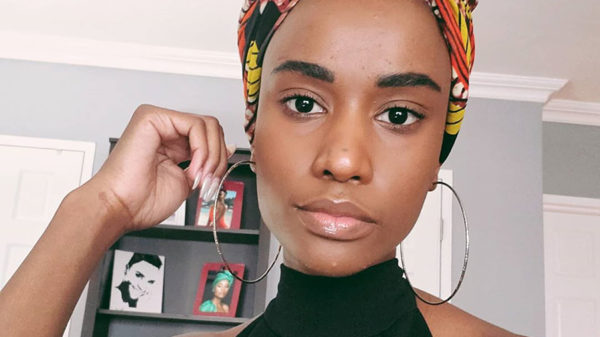 Zozibini Tunzi pairs patterned headscarf with hoop earrings in latest Instagram post